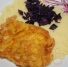Fried cheese with mashed potatoes and red cabbage